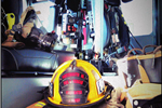 Fire Fighter Gear Sitting in the Cab of an Engine