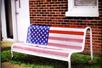 American Flag Painted Onto a Metal Bench